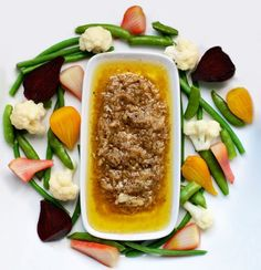 Bagna Cauda...we always just dip Italian bread or scoop up with a chunk of celery...mmm! A Christmas tradition.