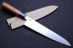 "YOSHIHIRO- Blue Steel#1 Hagane Wa Gyuto Chef Knife 10.5"" 270mm Yew Handle - MADE IN JAPAN by YOSHIHIRO. Save 17 Off!. $369.99. BOLSTER: Water Buffalo Horn (BOLSTER COLOR -VARIES) / Handle Material: Yew Handle. Knife Type: Gyutou Knife. Blade: Double-Edged / Blade Length: 10.5"" (270mm). Hardness Rockwell C scale: 63. Steel Type: Blue Steel #1 HAGANE, Virgin High Carbon Steel (not stain-resistant). About YOSHIHIRO- ""YOSHIHIRO"" has been designated as a one of the Best Sword Craftsman in Japan…"