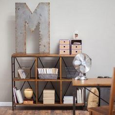 Use as a bookcase, display area, TV stand, or console.