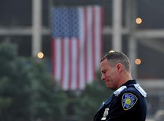 UNITED STATES, New York : Daniel Henry, a Port Authority of New York/New Jersey police officer, pauses during a moment of silence at 9:01 am EDT, at the South reflecting pool at the 9/11 Memorial during ceremonies marking the 12th anniversary of the 9/11 attacks on the World Trade Center in New York, September 11, 2013. AFP PHOTO / Stan HONDA