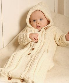 Free knitting pattern for cabled bunting bag  - This snuggle sleep sack by DROPS Design features a hood and buttoned front with cables.  Sizes 1/3 – 6/9 – 12/18 months (2 – 3/4) years