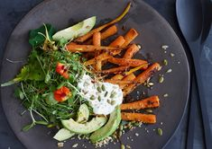 This is easily one of my favorite fall salads The creaminess of avocado and sour cream is amazing with the spiced zing of the carrots and the toasted, nutty seeds.