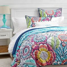 PB Teen Sunrise Garden Quilt, Cool Multi, Full/Queen at Pottery Barn... ($90) ❤ liked on Polyvore featuring home, bed & bath, bedding, quilts, beds, quilted pillow shams, flower bedding, navy blue shams, quilted bedding and flower stem