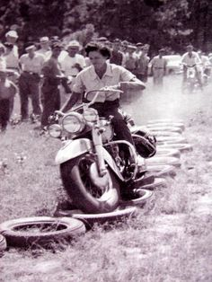 vintage pic of woman riding a panhead over tire course