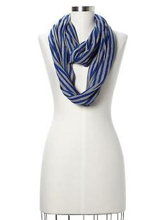 My stripey scarf is cream with thin navy stripes from H.