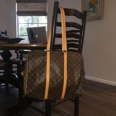 """Louis Vuitton Sac Flanerie (1999) Authentic Louis Vuitton Sac Flanerie overnight bag; date stamp NO0909; excellent condition with no oxidation to hardware; light patina from age (I'm the 2nd owner but I think the first owner had the leather conditioned when purchased new). I purchased in 2008 for $1250. Gorgeous travel staple; includes original dust bag. Free authentication by Posh so buy with confidence! Approx. 17"""" x 12.5"""" x 5.5"""". NO trades please  No stains or rips to lining---beautiful…"""