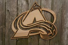 Hey, I found this really awesome Etsy listing at https://www.etsy.com/listing/212707145/colorado-avalanche-logo-wood-cut-wall