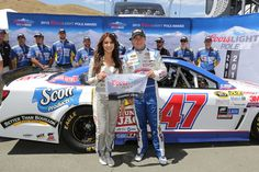 AJ Allmendinger, #47 Kingsford Charcoal Chevrolet, poses with Miss Coors Light Amanda Mertz and the Coors Light Pole Award after qualifying for pole position for the NASCAR Sprint Cup Series Toyota/Save Mart 350 at Sonoma Raceway
