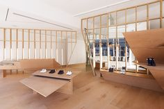 FEIT's flagship store in NY uses minimalistic design and simple materials to give the products the center stage. Open space, borrowed light, and views were achieved in this small modern retail space by designer Jordana Maisie.