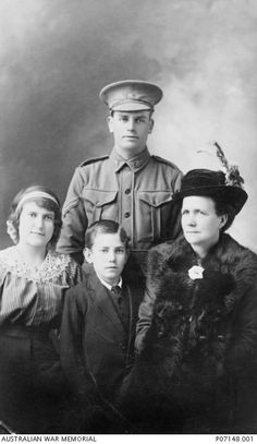Studio portrait of 1096 Driver (Dvr) Percival Harris, C Company, 18th Battalion, of Hurstville with his mother Mary Anne, his sister Elsie May and his brother Bill (William). Dvr Harris arrived in Gallipoli on 19 August 1915. He took part in a charge on Hill 60 between 21 and 25 August and was reported killed in action on Sunday 22 August 1915. Australian War Memorial collection - P07148.001. http://www.awm.gov.au/collection/P07148.001/