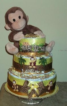 """Monkey N' Around"" diaper cake Great Gift or baby shower center-piece made of diapers and filled inside with many baby items"
