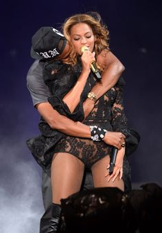Crazy in love. Jay Z and Beyoncé cuddle during their performance on July 11 in East Rutherford, N.J.