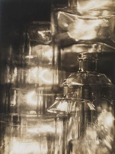 """Horacio Coppola, """"Transparencias"""", 1928. Coppola learned the basics of photography from his older brother Armando, an amateur photog. He then oobtained a classic bellows camera and started experimenting with glass bottles and a prism from his father's construction workshop. By placing the objects between the camera and a lamp, Coppola captured the light refracted by and reflected off the glass, turning still-life compositions into experiments in abstraction."""