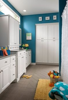 Kids bathroom- black and white floor, white cabinets, peacock blue walls, yellow accents want a room in this blue color or just a wall..