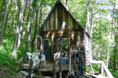 Cabin in West Jefferson, United States. Cozy rustic 12x12 tiny forest cabin nestled in the Appalachian mountains on our 16 acre off grid solar/H2O permaculture farm, surrounded by 4500 protected acres.  Experience life in our magical forest space; pond, creeks, boulders & hiking on site...