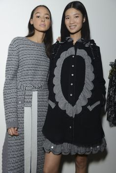 Ryan Lo's #AW14 show - A long and slinky knitted dress with silver buttons down the front screamed Coco Chanel in the Thirties, while the semi-sheer sparkly dresses made us want to hit the disco. #RyanLo #LFW #AW14 #TopshopShowspace #NEWGEN