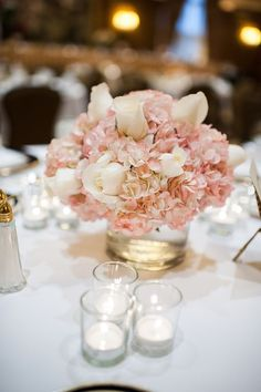 Gorgeous blush floral wedding reception centerpiece; Featured Photographer: Chelsea Brown Photography