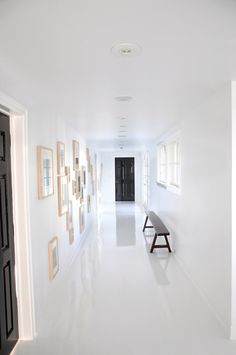 Gloss white tiles with minimal grout can get this gloss affect! Paired with white walls and minimal furniture leave this clean and sophisticated look!