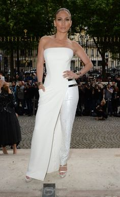 Girls always looks ridiculous amazing - Singer and actress Jennifer Lopez donned a 'tress' (trouser/ dress hybrid) to watch the Versace show on SUnday evening Atelier Versace