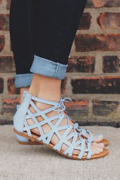 Crossroads Sandals-We are obsessed with baby blue this season and our Crossroads Sandals are no exception! They are a pair of faux leather, cutout, gladiator style flat sandals featuring a lace up front, zipper back and gold embellishments
