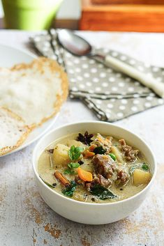 Mildly spiced Kerala mutton stew is made by simmering morsels of mutton and potato in coconut milk. Here is a simple, pressure-cooker version of this hearty delicacy.