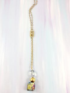 """""""Curious Minds"""" - Mid century gold and rhinestone medallion paired with rainbow flashed Quartz on rainbow Quartz chain"""