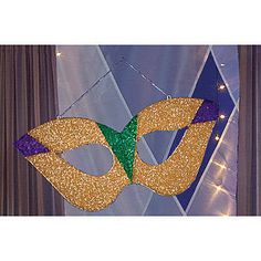 The Reusable Charade Glitter Mask Features Colorful Glittery Fabric In Gold Purple And Green Attached Mardi Gras