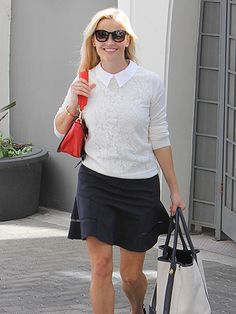 Reese Witherspoon looked perfectly put together 'n' slightly patriotic in a navy, white and red outfit, topped off with trendy round sunnies!