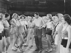 Scene from the 1933 musical Street. In the center of group of dancers are: actress Ruby Keeler as Peggy Sawyer, actor Warner Baxter as broadway director Julian Marsh, and actress Ginger Rogers as Ann Lowell. Classic Movie Quotes, Dance Pictures, Dance Pics, Little Theatre, The Neverending Story, Vintage Dance, Ginger Rogers, 42nd Street, Old Hollywood Glamour