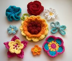 10 free patterns for some cute (and some not really cute at all) flowers:  Yes, there really are free patterns (links to them are on this page)
