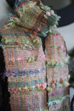 I like the use of the knobby art yarn in this weaving.