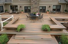 ground level wooden decks with planters firepits and benches - Google Search