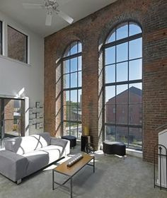 BEAUTIFUL urban loft.  I would LOVE to have a brick wall with windows like this in my house!