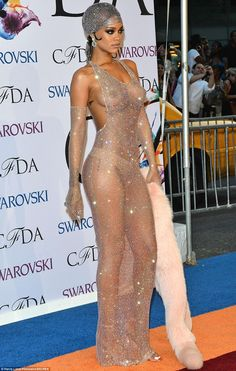 Working it: Rihanna's fur accessory dragged on the floor as she pulled her best pose for photographers