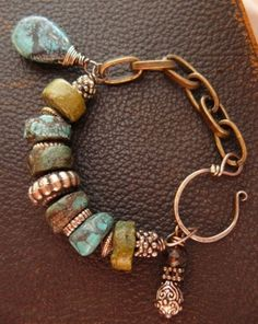 "Use ""odds & ends"", orphan beads. mixed metal spacers & large chain for unusual bracelet"