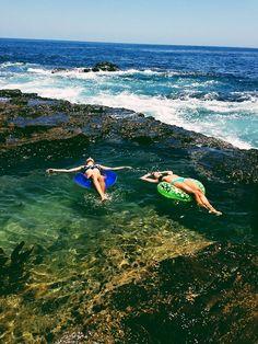 Floating in Queen's Bath Kauai Hawaii...