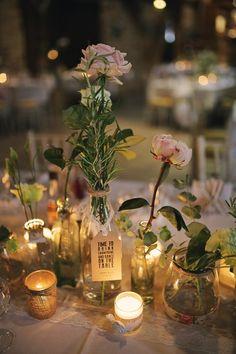 Bottles Jars Flowers Tea Lights Bottles Stylish Pastel Rustic Barn Wedding http://helenrussellphotography.co.uk/