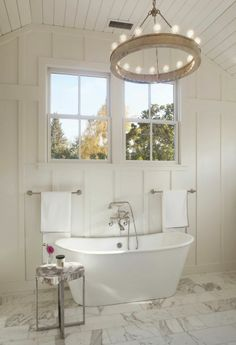 loving this light fixture + marble floors in this bathroom