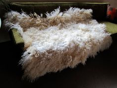 """modernfiberlab _ etsy __ wool felt throw or rug _ $700 _ This """"felt pelt"""" is wet felted by hand using traditional ancient techniques. This is made with natural colored lincoln longwool and merino and romney wool. I source the fleece from shepherds which I receive raw right after shearing. I clean, comb, and card the wool and then using hot water and organic soaps, felt by hand the wool fibers into one large piece. The lincoln longwool is sourced from my favorite farm in Michigan and is very…"""