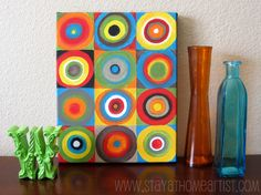 I made this colorful canvas art to add to my kitchen decor... (Yes my kitchen is accented in crazy bright colors.  That's how I roll.)   The...