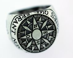 Compass Signet Ring The edge of the ring reads 'Omnes Qui Errant Non Pereunt' which translates from Latin to 'Not All That...