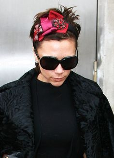 Pin for Later: Victoria Beckham's 45 Most Fabulous Moments in a Pair of Sunglasses To Bring Edge to a Playful Embellished Bow