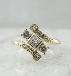 A new square-cut diamond gives this vintage bypass-style setting a little extra sparkle. #etsyweddings