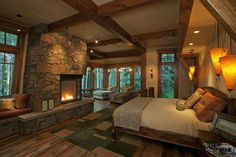 Rustic Contemporary - In this master bedroom, the contemporary fireplace design pairs well with the moss rock. Reclaimed white oak floors add a layer of rusticity to the space, and once again, there is a wonderful feeling of bringing the outdoors into the Cabin Homes, Log Homes, Rustic Country Bedrooms, Bedroom Rustic, Bedroom Romantic, Rustic Room, Rustic Cottage, Rustic Country Decor, Rustic Master Bedroom Design