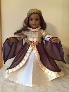 Gorgeous shimmering ivory and burgundy Renaissance style gown and crown for 18 inch dolls. Beautiful and lots of detail! Perfect for a custom doll