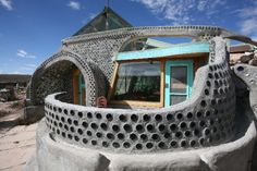 The Earthship--a completely sustainable home built from old tires and other recycled materials. Natural Building, Green Building, Maison Earthship, Earthship Home Plans, Unusual Homes, Earth Homes, Architecture, My Dream Home, Sustainable Architecture