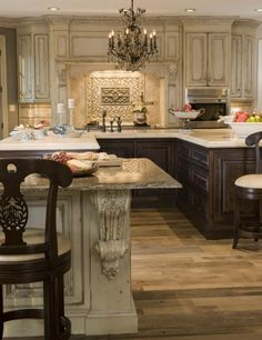 Gorgeous!  I love the white antique wash upper cabinets combined with the dark lower cabinets.