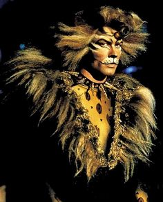 John Partridge playing the character of Rum Tum Tugger from Cats (the musical).  I would never have believed that I would find this one of the hottest things ever, but it really is.