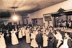 In Cripple Creek, Colorado, prostitutes and dance hall girls were required to wear aprons over their short dresses, lest anyone be offended at seeing their ankles. These gals and their cohorts are having a fine time at Crapper Jack's. The famed Laura Bell McDaniel of Colorado City is said to be among them.