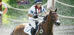 Queen's granddaughter,	Zara Phillips, rides High Kingdom in the equestrian eventing cross-country phase.